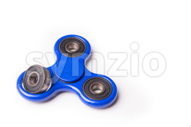 Dislodged broken weight from fidget spinner dangerous to kids Stock Photo