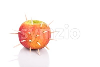Conceptual of apple with thorns denote sharp pain when bite Stock Photo