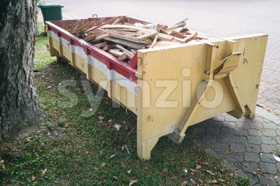 Construction rubbish dumpster with waste at construction site Stock Photo