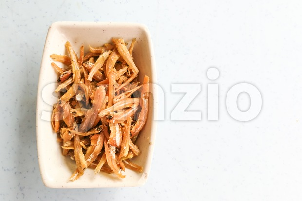 Plate of fried crispy anchovies, Asian style recipe as condiment