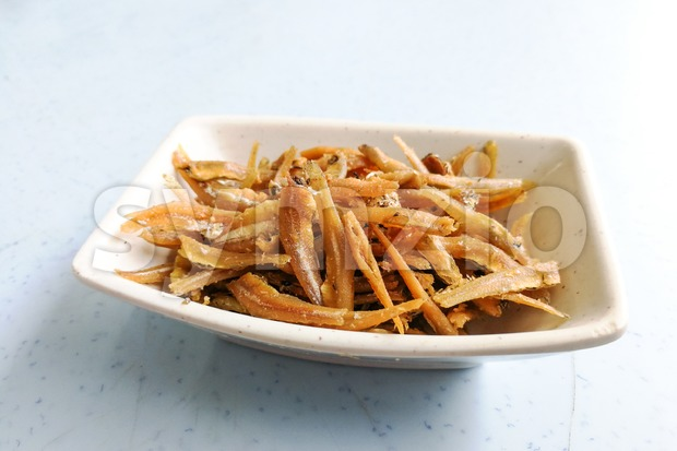 Plate of fried crispy anchovies, Asian recipe Stock Photo