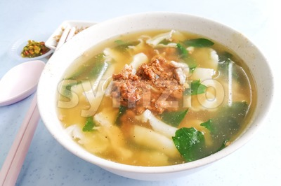 Flat flour noodle soup or Pan Mee, popular Malaysia cuisine Stock Photo