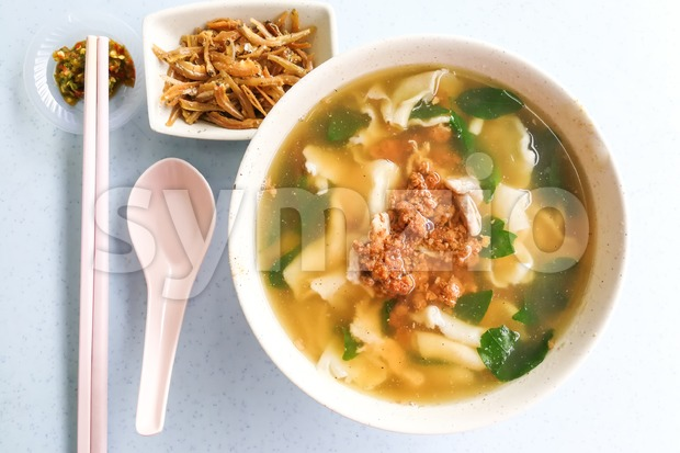 Flat flour noodle soup or Pan Mee, popular traditional Malaysia Chinese cuisine