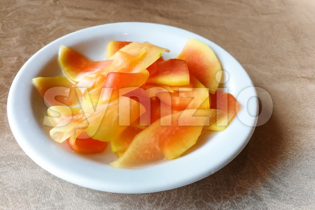 Plate of pickled papaya, delicacy in Southeast Asia Stock Photo