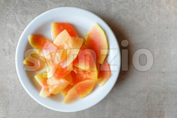 Plate of pickled papaya, delicacy in Southeast Asia as appetizer before meal