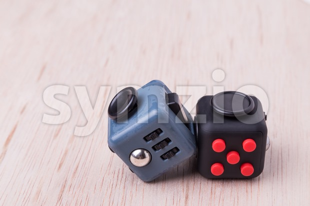 Fidget cube, the stress relieving cube on table top Stock Photo
