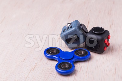 Fidget spinner and fidget cube, the latest stress relieving craze Stock Photo