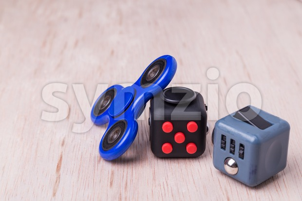 Fidget spinner and fidget cube, the latest stress relieving craze on table top