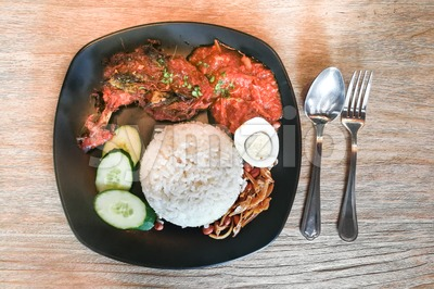 Nasi lemak with fried chicken, popular cuisine in Malaysia Stock Photo