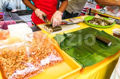 Muslim shoppers buying food from street vendor for breaking fast or iftar Stock Photo