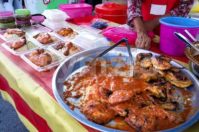 Ayam percik or grilled chicken, popular Malay food in Malaysia Stock Photo