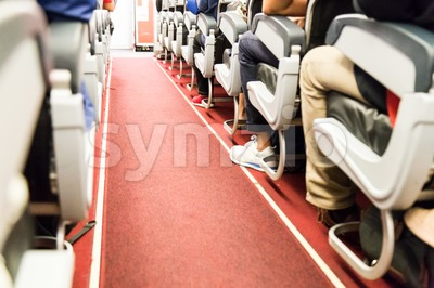 Floor proximity reflector line aids airplane evacuation under dark conditions. Stock Photo