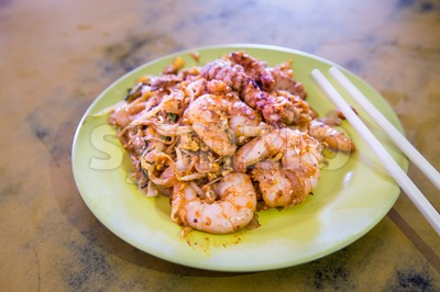 Penang Char Kuey Teow or fried noodle with big prawns Stock Photo
