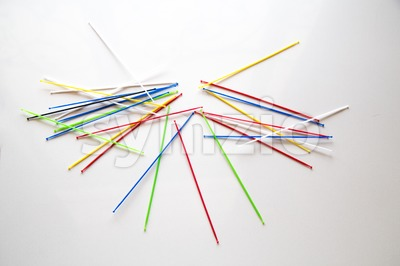 Pile of pick up sticks fun game overlapping Stock Photo