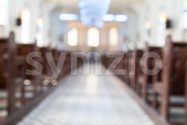 Defocused interior of Catholic church with pews Stock Photo