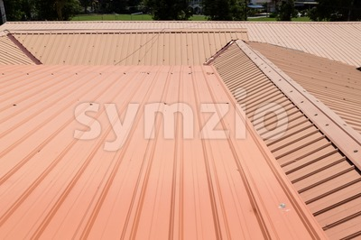 Strip of running metal roof of a building Stock Photo