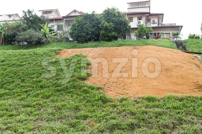 Slope erosion with grids and grass planted on steep slope Stock Photo