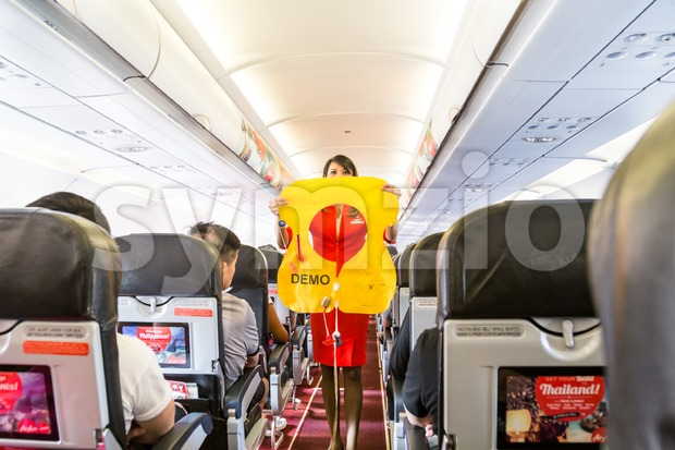 KUALA LUMPUR, Malaysia, June 8, 2017: Airasia hostess demonstrate safety procedures to passengers prior to flight take off Stock Photo