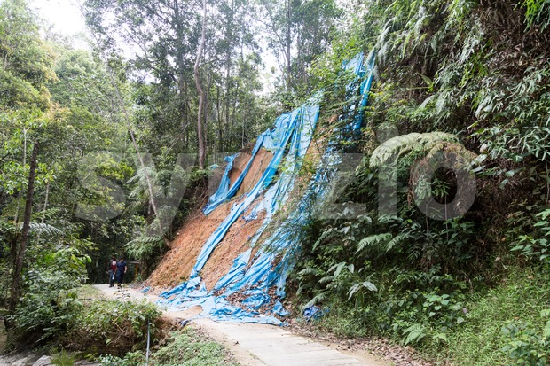Soil erosion at tropical hilly terrain due to rain storm. Stock Photo