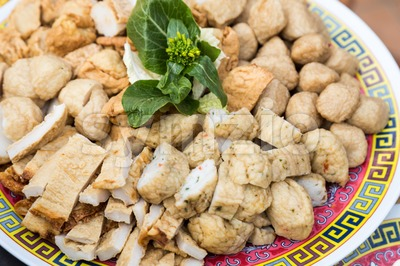 Close-up on plate of fish ball fish cakes for steamboat dining Stock Photo