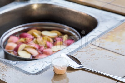 Soak apple in water with salt to prevent oxidation Stock Photo