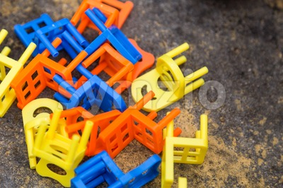 Heap of colorful chairs from the Stacking Chairs Game Stock Photo