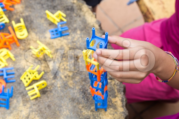 Kids playing the stacking chairs game during party Stock Photo