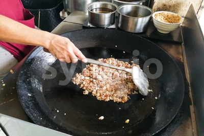 Hawker frying cooking fried carrot cake or kueh kak Stock Photo