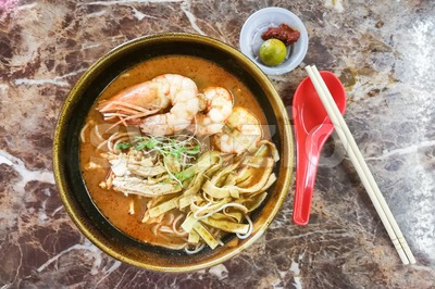 Authentic delicious Sarawak Laksa with big prawns Stock Photo