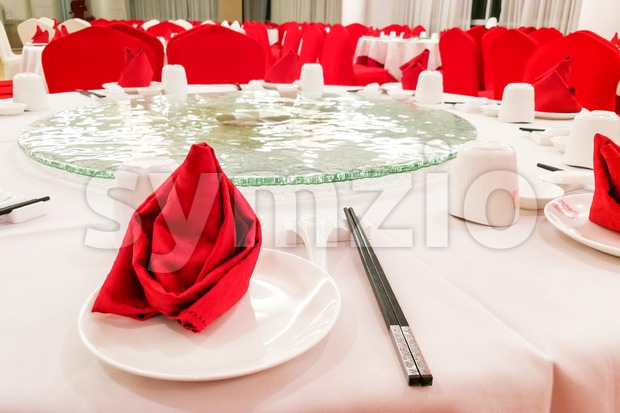 Typical generic Chinese wedding dinner banquet set-up with dinnerware arranged
