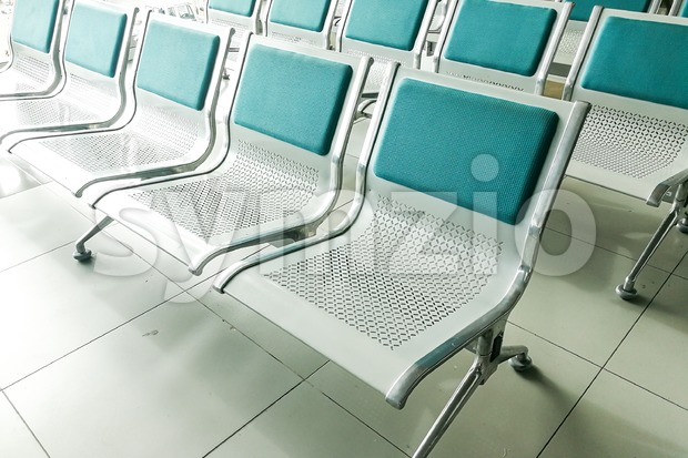 Rows of empty chairs at waiting area Stock Photo