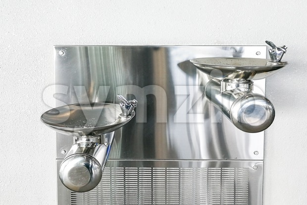 Filtered water cooler dispenser station facility at public area Stock Photo