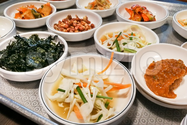 Korean meal side dishes of vegetable, kinchi, groundnuts, garlic, bean sprout, seaweed, meshed potatoes