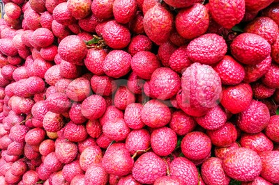 Close-up on heap group of lychee fruits tied together Stock Photo