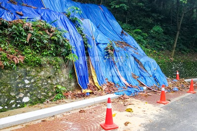 Cones barricade dangerous collapsed eroded hill slope area Stock Photo