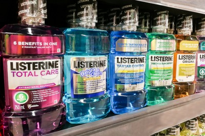 KUALA LUMPUR, Malaysia, June 25, 2017: Listerine is a brand of antiseptic mouthwash product. It is promoted with the slogan Kills germs that cause Stock Photo