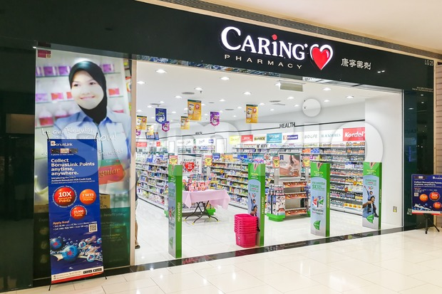 KUALA LUMPUR, Malaysia, June 25, 2017:  CARiNG Pharmacy Group Berhad operates a chain of community pharmacies They carry pharmaceutical, personal care Stock Photo