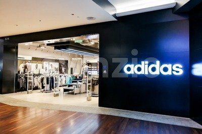 KUALA LUMPUR, Malaysia, June 25, 2017: Adidas AG is a German multinational corporation, headquartered in Herzogenaurach, Germany, that designs and Stock Photo