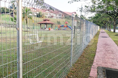 Security fencing at residential home to prevent trespassing Stock Photo