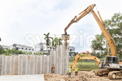Crane lifted and placed concrete bars into position. Stock Photo