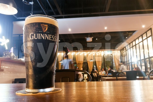 Kuala Lumpur, Malaysia, July 1, 2017:  Guinness is an Irish dry stout that originated in the brewery of Arthur Guinness at St. James's Gate brewery, Stock Photo