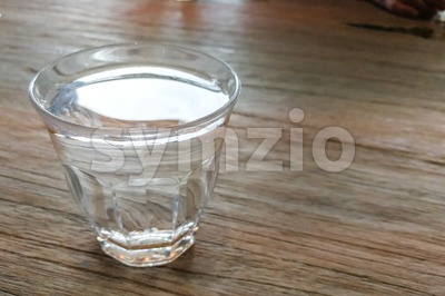 Glass of pure purified mineral drinking water on table Stock Photo