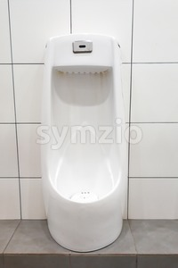 Modern clean hygienic men urinal ware in public washroom toilet Stock Photo