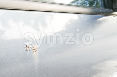 Car with corroded rust stain on door Stock Photo
