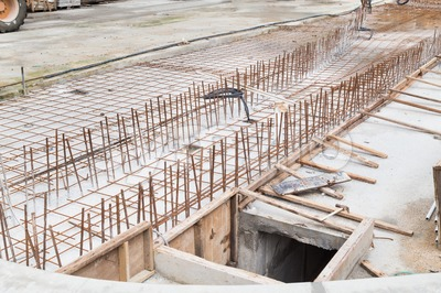 Concreate metal mesh rebar at constructiion site for floor foundation Stock Photo