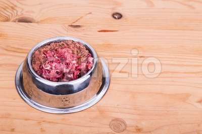 Fresh and nutritious minced raw meat dog food in bowl Stock Photo