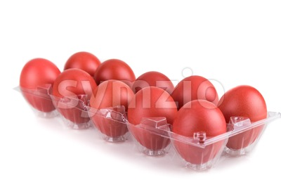 Tray of red color eggs for festive greetings and gift Stock Photo