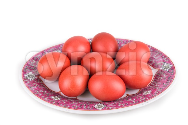 Red color eggs on oriental Chinese plate for good luck Stock Photo