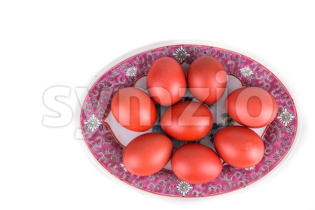 Red color eggs on oriental Chinese plate for birthday greeting and good luck