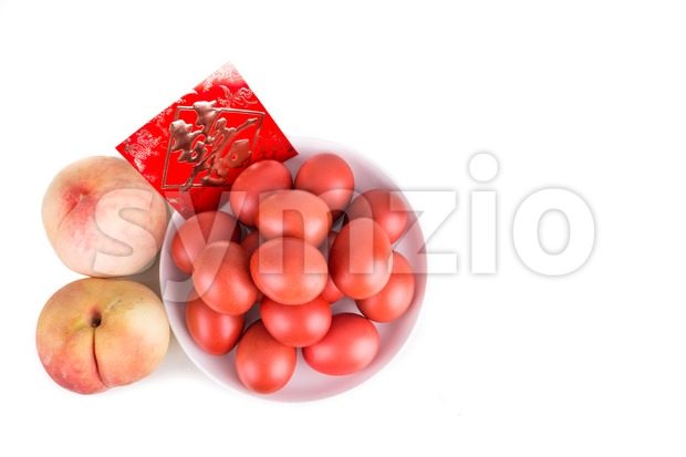 Red color eggs and peach with an envelope with Chinese word Celebration
